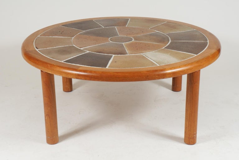 A great sized sturdy Danish teak coffee table with ceramic tile top. Very usable and stunning solid Danish coffee table. The table is designed by Tue Poulsen and labeled Haslev. Made in Denmark. Perfect for any 'Hygge' environment!