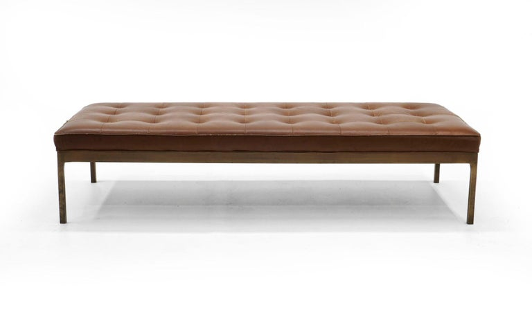All original bronze frame leather museum bench / daybed designed by Nico Zographos. Beautifully patinated solid bronze frame with the original brown leather in good condition with no tears or holes. We had the bench refoamed so it sits like new.