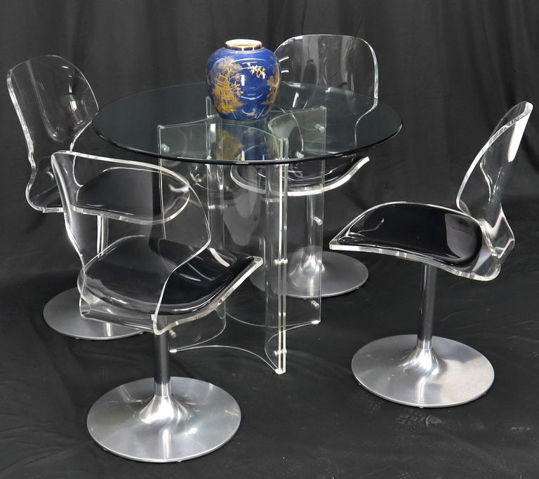 Stunning Mid-Century Modern Lucite and tulip chrome bases chairs with matching round 36 diameter x 29
