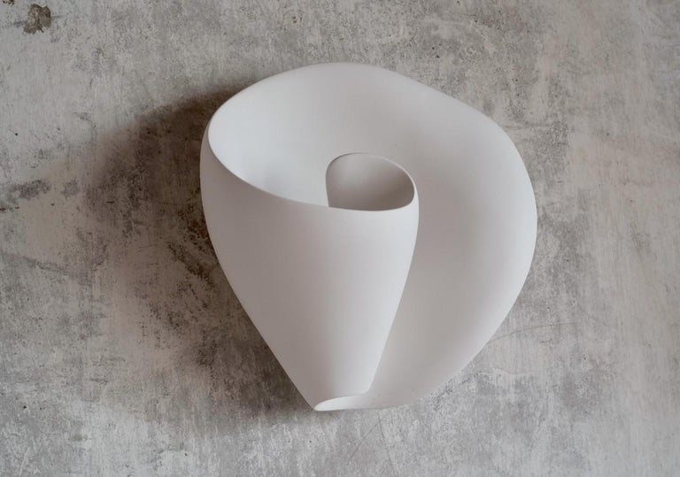 Handmade Tulip wall-mounted sculpture, in silky smooth white plaster, created by artist Hannah Woodhouse in her London studio. Contemporary design inspired by nature and midcentury European sculpture. Height 11.8