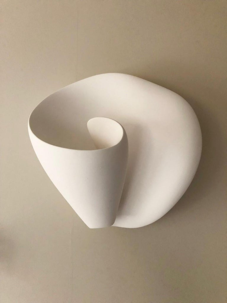 Handmade Tulip organic modern wall light/ wall sconce, in silky smooth white plaster, created by artist Hannah Woodhouse in her London studio. Contemporary organic modern design inspired by nature and midcentury European sculpture. The Tulip wall