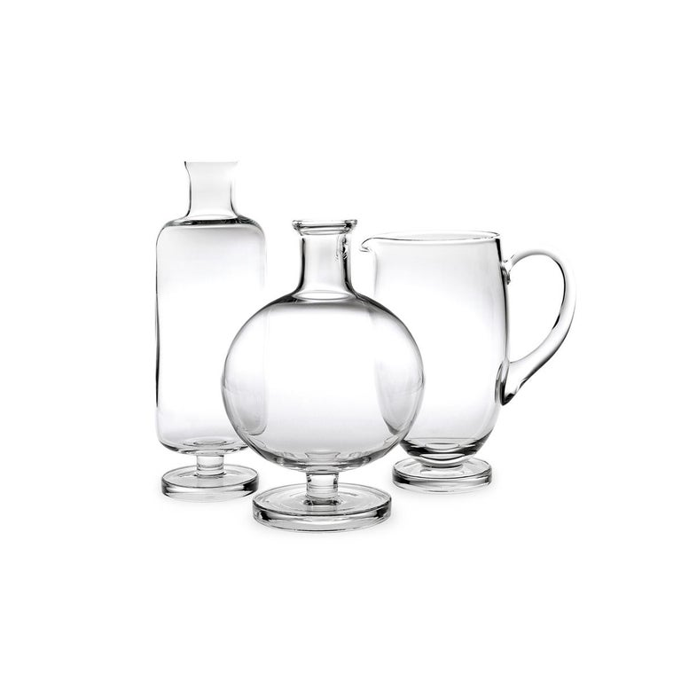 Carafe made in blown in a mold glass. The Tulip collection is a glassware family by Aldo Cibic, who designed these pieces walking the line between classical and postmodern design. The boldly simple geometric forms are at once contemporary and