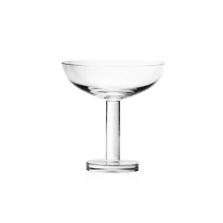 Champagne or martini glass made in blown in a mold glass. The Tulip collection is a glassware family by Aldo Cibic, who designed these pieces walking the line between classical and postmodern design. The boldly simple geometric forms are at once