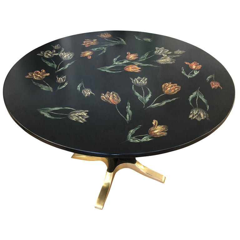 """Tulipani"" dining or centre table by Piero Fornasetti depicting colorful tulips on a black background. Wood base with brass feet. Original label below top.