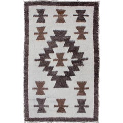 Tulu Carpet with Brown Tribal Design Set on White Field
