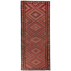 Turkish Kilim Runner Rug with Green and Pink Tribal Details on Black Field