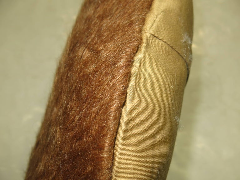 A large pillow made with a brown Turkish Mohair rug.
