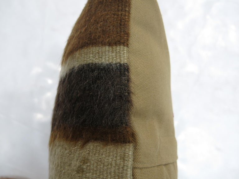 A small pillow made with a brown Turkish Mohair rug.