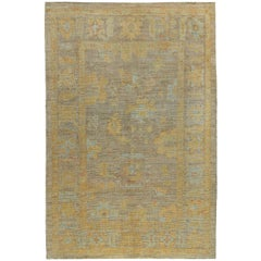 Turkish Oushak Rug with Blue and Gold Floral Patterns on Ivory and Brown Field