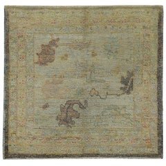 Turkish Oushak Rug with Brown and Gold Floral Details on Ivory Field