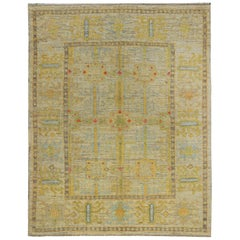 Turkish Oushak Rug with Gray and Gold Floral Heads on Ivory Field
