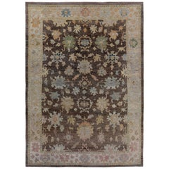 Turkish Oushak Rug with Green and Pink Flower Patterns on Brown and Ivory Field