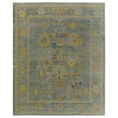 Turkish Oushak Rug with Ivory & Gold Floral Details on Blue Field