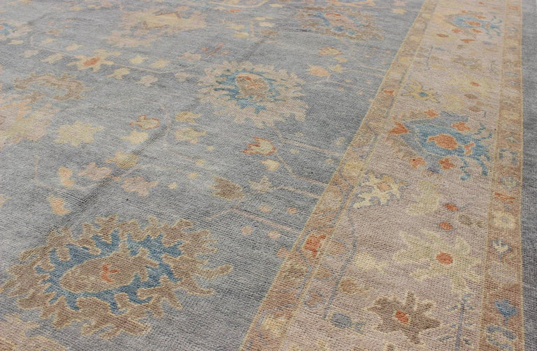Wool Turkish Oushak Rug with Neutral Color Palette and All-Over Flower Design For Sale