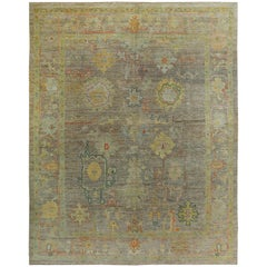 Turkish Oushak Rug with Orange and Gold Floral Details on Brown Field