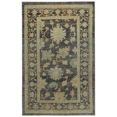 Turkish Oushak Rug with Pink and Gold Floral Details on Brown Field