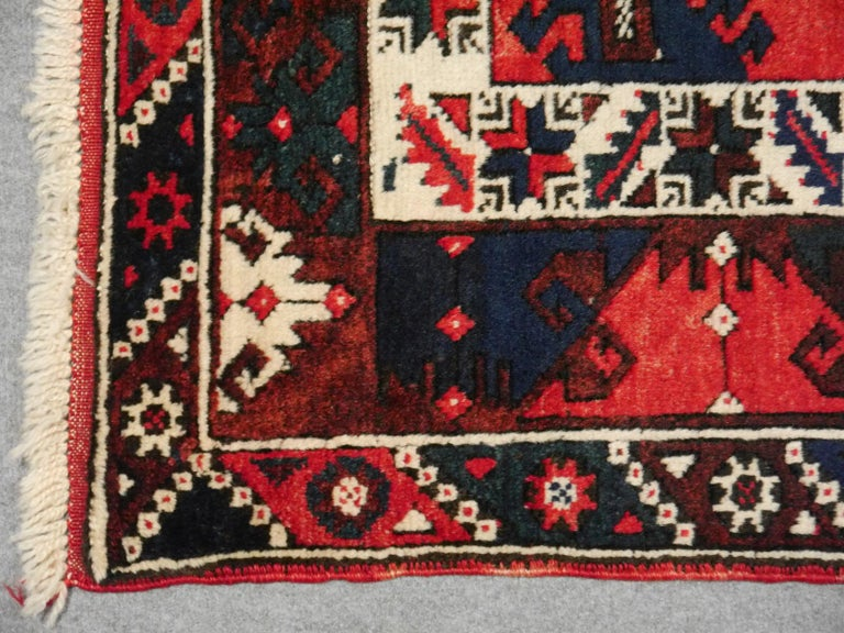 Vintage semi antique oriental accent rug, carpet or mat.  Vintage Turkish rug excellent condition, nice colors. This rug was hand knotted in the village of Dosemealti, It has an pretty red field with blue and beige traditional motives. The fringes