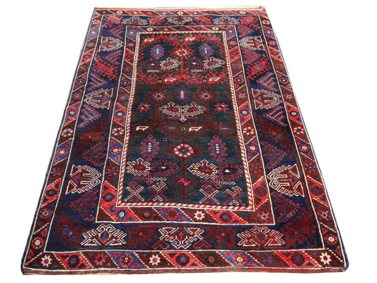 Vintage semi antique oriental accent rug, carpet or mat.  Vintage Turkish rug excellent condition, rare colors. This rug was hand-knotted in the village of Dosemealti, It has an unusual green field with blue and red traditional motives. The