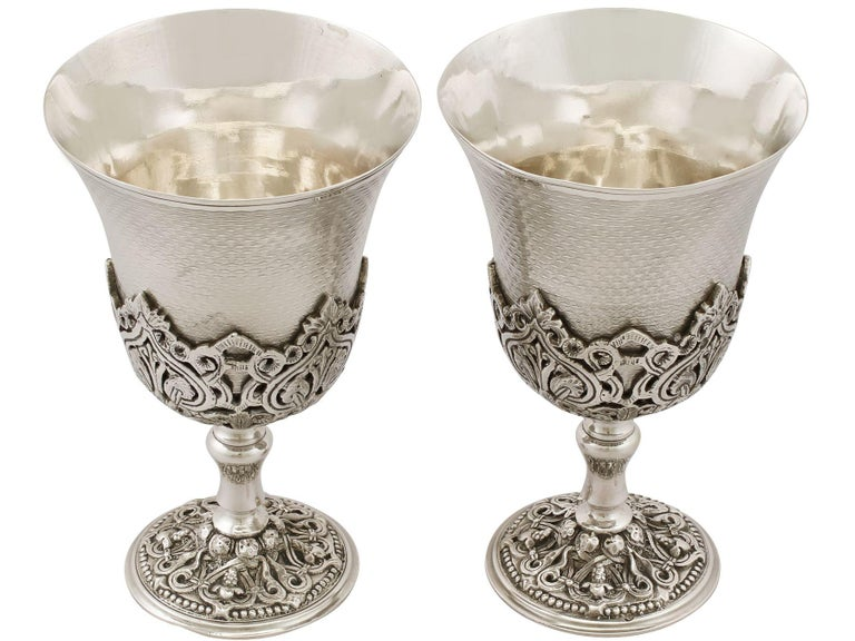 An exceptional, fine and impressive pair of antique Turkish silver goblets; an addition to our range of wine and drink related silverware  These exceptional antique Turkish silver goblets have a circular bell shaped form onto a waisted pedestal, to
