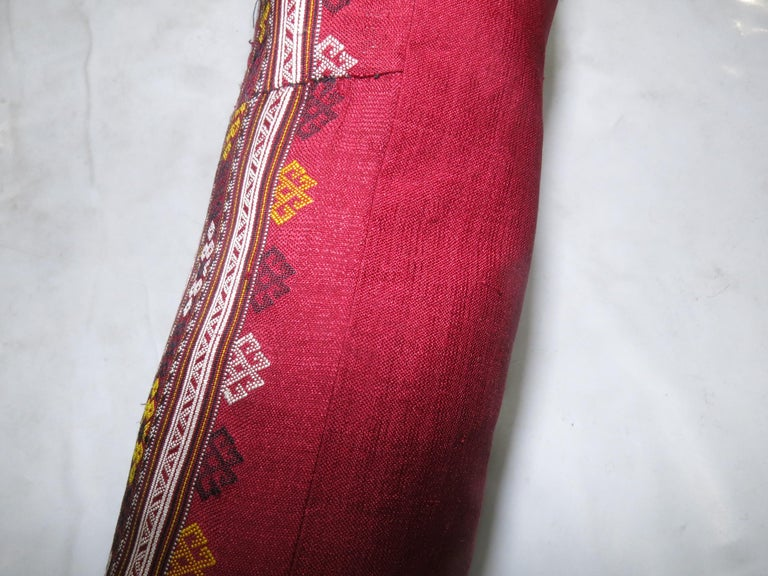Pillow made from a mid-20th century Turkish textile. Bolster size. 11'' x 24''.