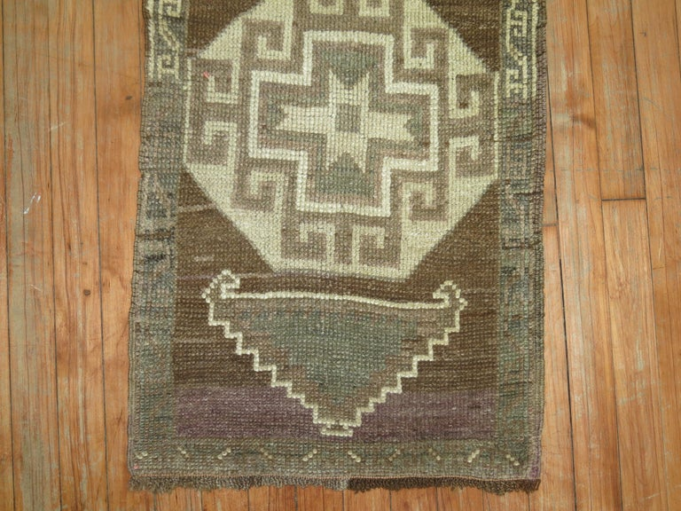 Vintage Turkish rug with an oatmeal brown field.