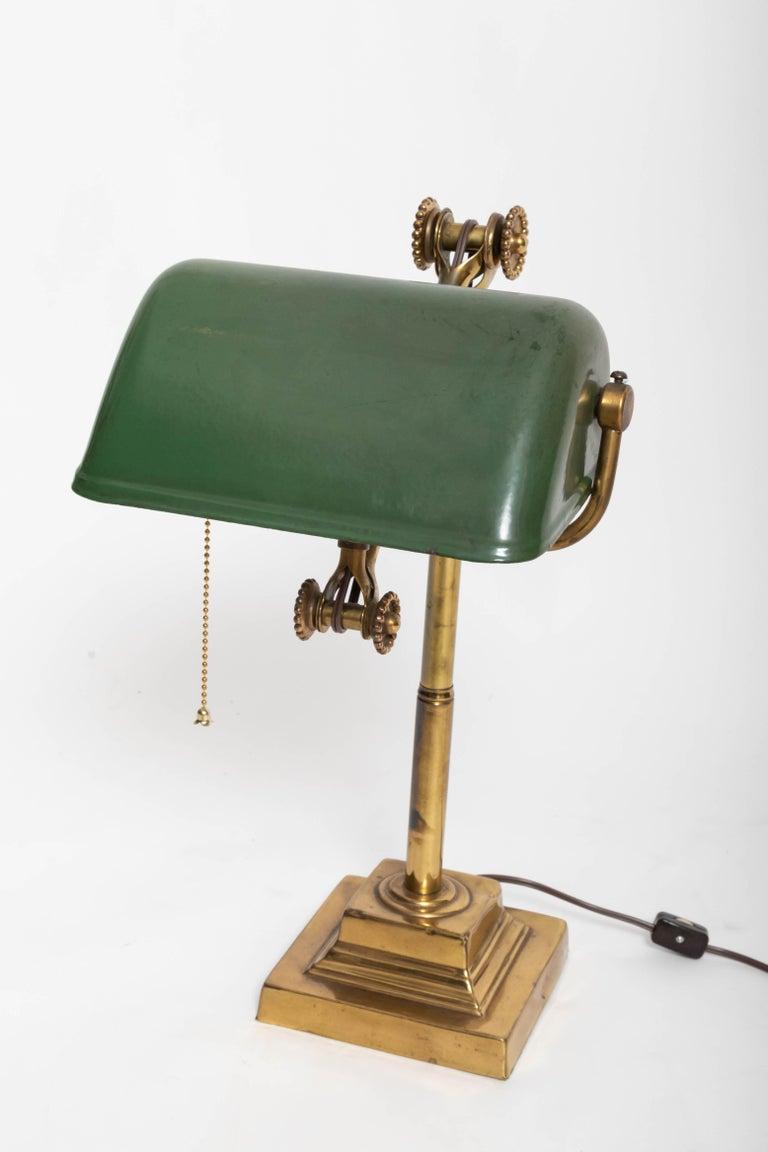 Adjustable brass arm, adjustable dark green metal shade.
