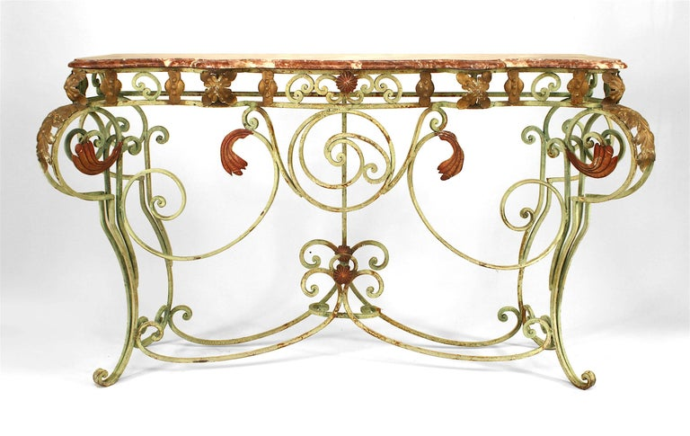 Turn of the century French console table with a rectangular rouge marble top supported by scroll design legs and stretchers composed of green-painted iron with red and gold leaf trim.  For matching mirror, see dealer reference number 062069.