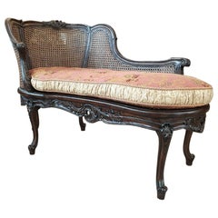 Turn of the 19th-20th Century Dark Wood Chaise Lounge Finished with Rattan