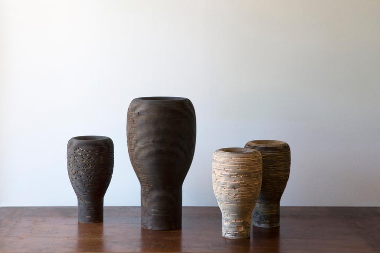 This cypress wood vase is designed by Massimo Barbierato and handmade for Hands on Design by Lorenzo Franceschinis, a talented artistic turner. The material look is emphasized by the striped texture, the finishing, made starting from rust oxides,