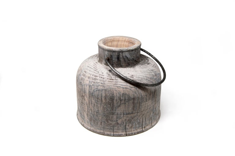 This pine wood vase is designed by the couple Setsu&Shinobu Ito and handmade by the artistic woodturner Lorenzo Franceschinis for Hands on Design. It is inspired by the ancient steel milk containers and the surface finish is made from titanium