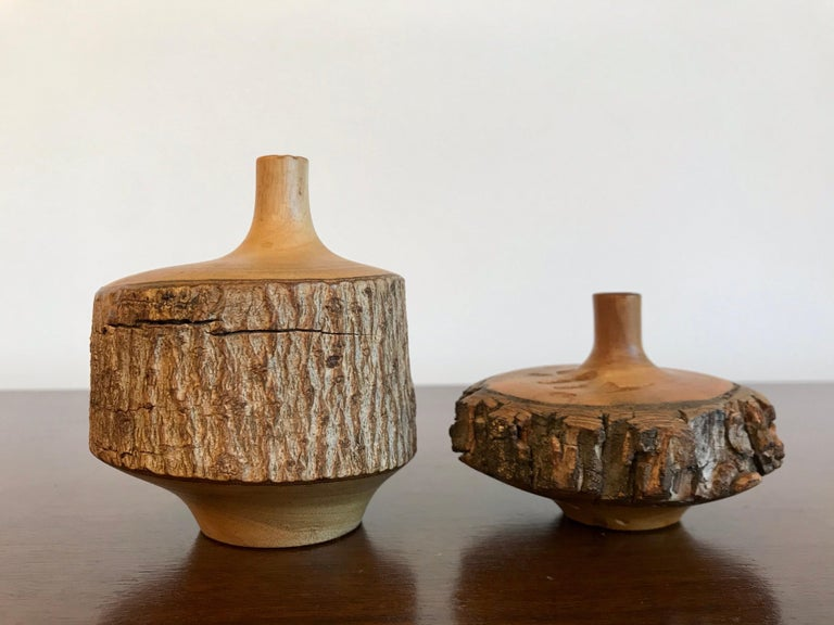 A nice pair of weed vases with natural bark detailing great as decorative accents the smaller one is 2.5
