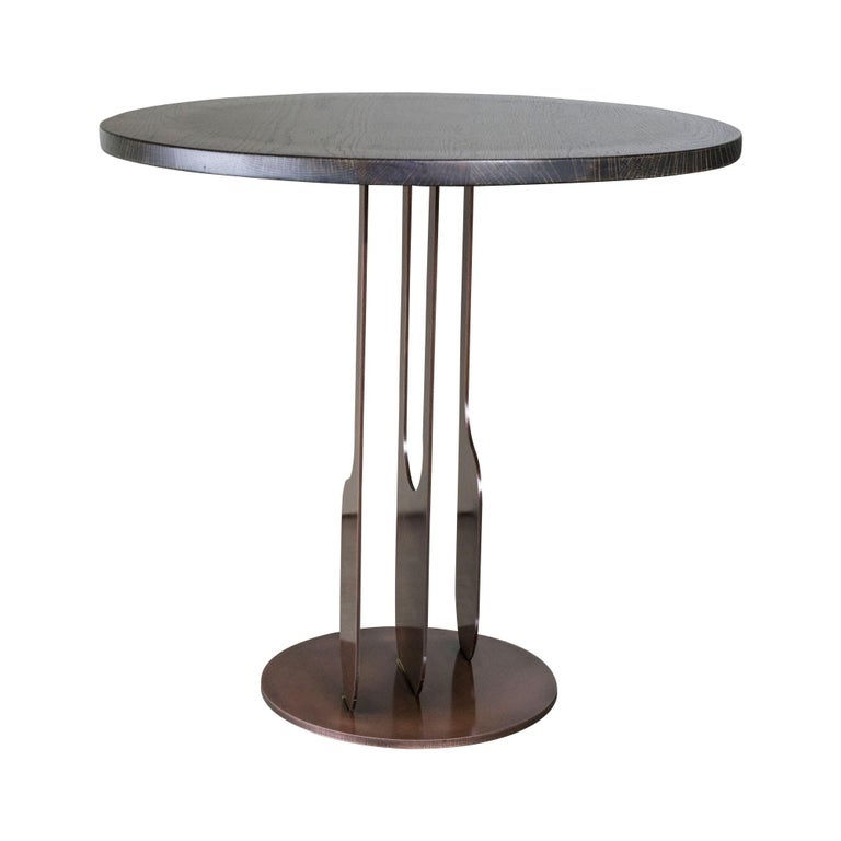 Round side table with copper finished steel base and stained oak top.