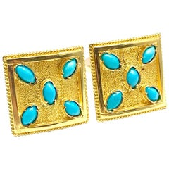 Turquoise and 18 Karat Yellow Gold Cufflinks with a Toggle Back