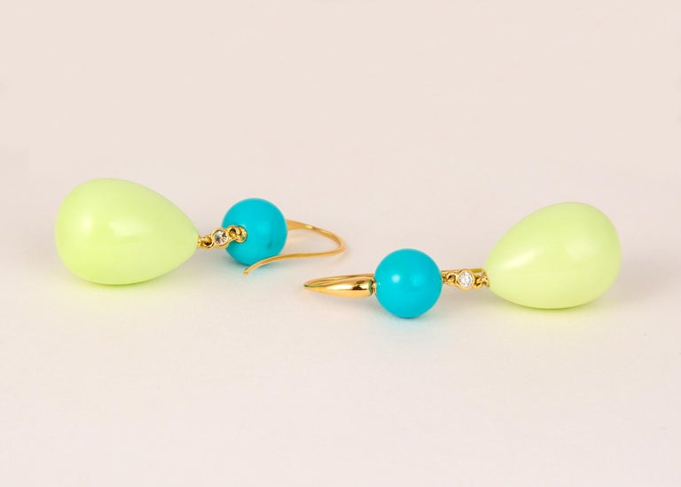 This one of a kind earring features the great color combination of turquoise and lemon chrysoprase and a single brilliant cut diamond all in handmade 18k mountings. 2 inches in length.