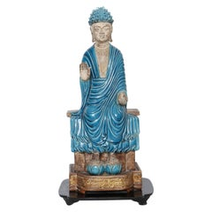 Turquoise and Parcel-Gilt Terracotta Buddha on Stand