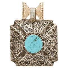 Turquoise and Sterling Silver Carved Pendant
