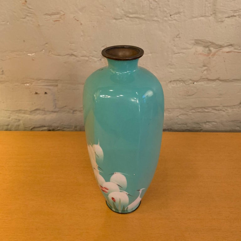 Lovely, enamel over copper, turquoise blue vase depicting cascading birds has originated most likely from China, circa 1930s.