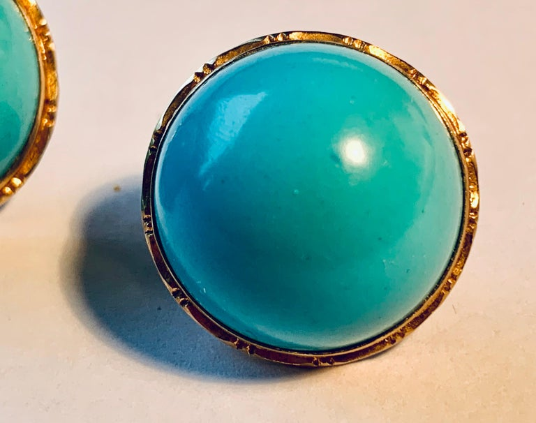 Pair of round 14k yellow gold engraved earrings set with cabochon turquoise stones.  The backs are clips and posts.  The posts can be removed for non pierced wearers.  The are marked 14k and 585.