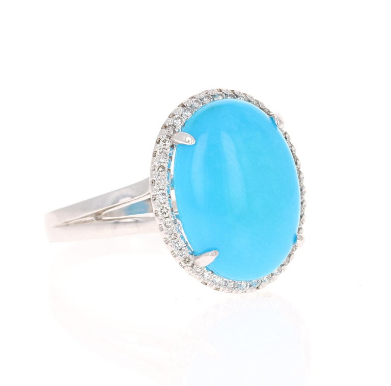 The Oval Cut Turquoise is 5.37 carats and measures at 12 mm x 16 mm. It is surrounded by 40 Round Cut Natural Diamonds that weigh 0.23 carats. (Clarity: VS, Color: H) The total carat weight of the ring is 5.60 carats.  The ring is crafted in 14