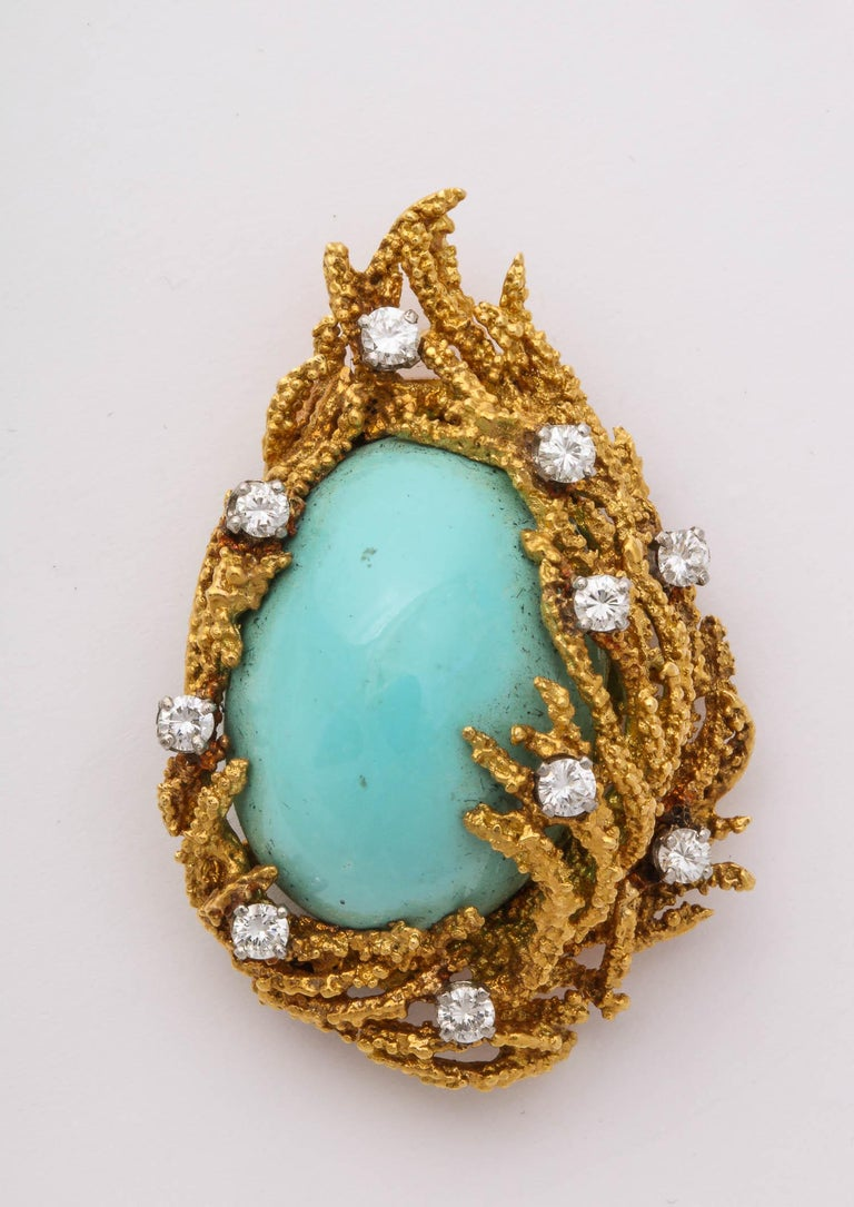 18k abstract gold brooch, centering a large cabochon Natural Turquoise (25 x 18mm)  10 diamonds 1.00 carat, 28 grams of 18k yellow gold