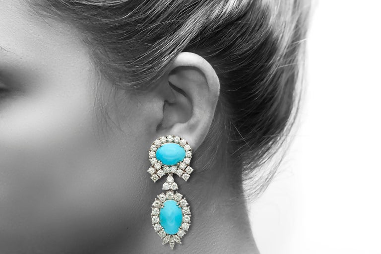 Earrings, finely crafted in 18k white gold with diamonds weighting a total of 7.51 carats and turquoise weighting approximately a total of 26.70 carats. Circa 1980's.