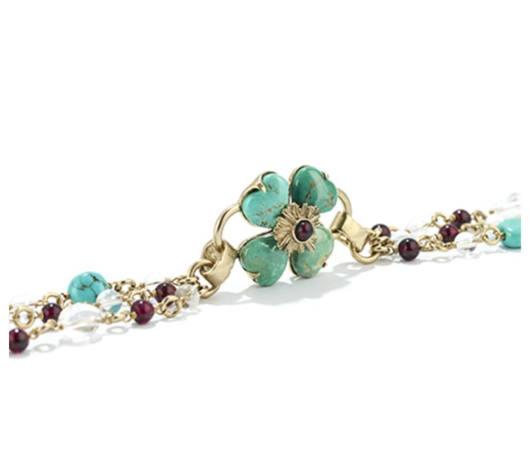 """Long necklace made with turquoise, garnet, pearl, and rock crystal from Goossens Paris.  Clover flower is 1""""x1""""."""