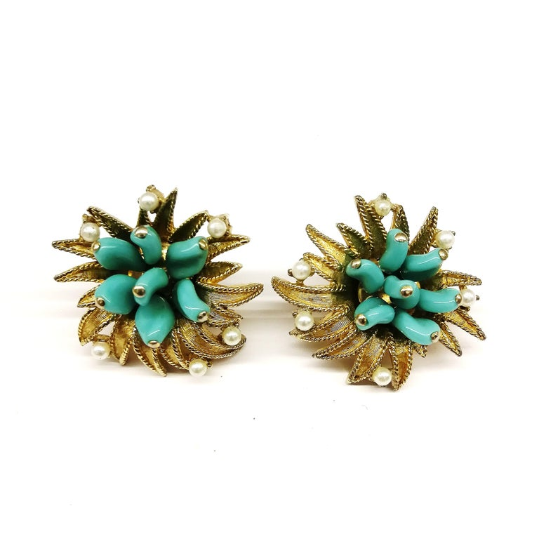 Bright 'sunburst' style earrings with turquoise glass 'petals' and paste pearls, from Marcel Boucher, displaying the high quality always found with this designer. Not highly dressy, but bright and glamorous, making these earrings very