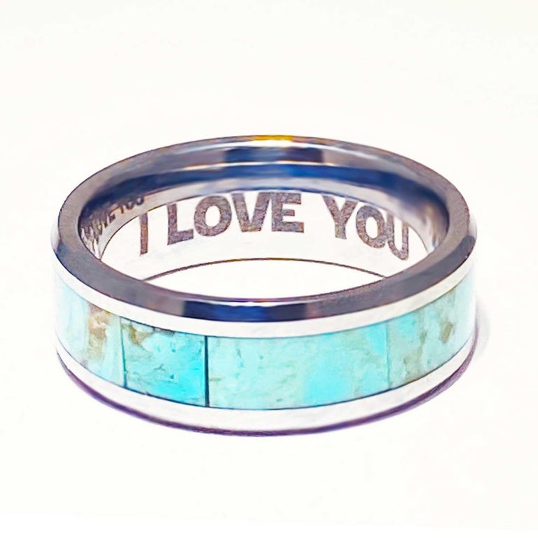 This men's wedding band is a statement fine jewelry piece! Natural turquoise inlay men's bands are a new and exciting design! The genuine turquoise gemstone inlay is a crystal blue color design inspired by clear blue ocean waters. The peaceful