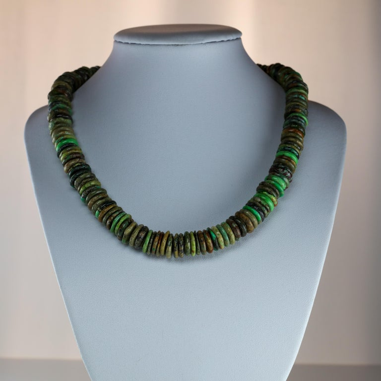 In my many years of collecting jewelry, I have never come across a necklace quite like this one. The 16.5-inch choker-length necklace is composed of 164 approximately disks of fine, natural and un-treated turquoise disk beads, measuring