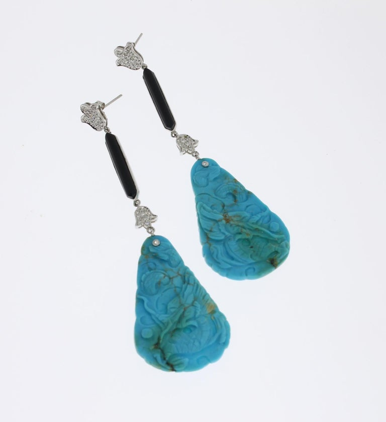1970's. Set with 2 carved turquoise and onyx. Decorated with 44 brilliant-cut diamonds weighing ca. 0,42 ct. Mounted in 18 K white gold. Total weight: 12,44 g. Length: 3.54 in ( 9 cm )