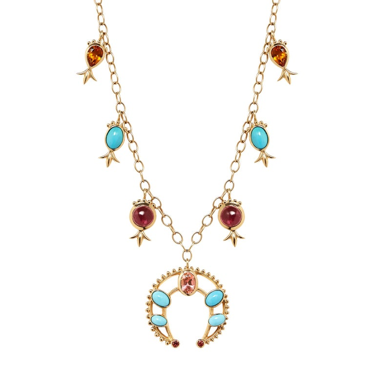 This Marlo Laz 14 Karat yellow gold turquoise, pink tourmaline, orange sapphire and orange citrin squash blossom necklace is inspired by the southwest and an ode to Native American Navajo jewelry. Our iconic pink-orange Marlo Laz color palette goes