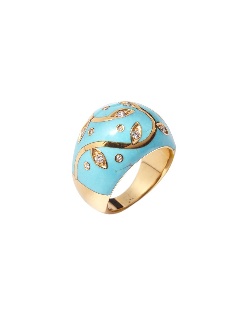 Ring sculpted in top quality Iranese turquoise with floral decoration executed with high carat yellow gold inlay and set with faceted diamonds.  Admire the beauty and craftsmanship of this ring, a piece that is truly unique; you will not find