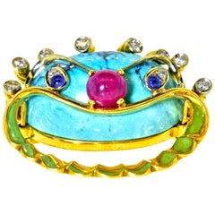 Turquoise, Ruby, Sapphire and Diamond 18 Karat Clam motif Brooch, circa 1960