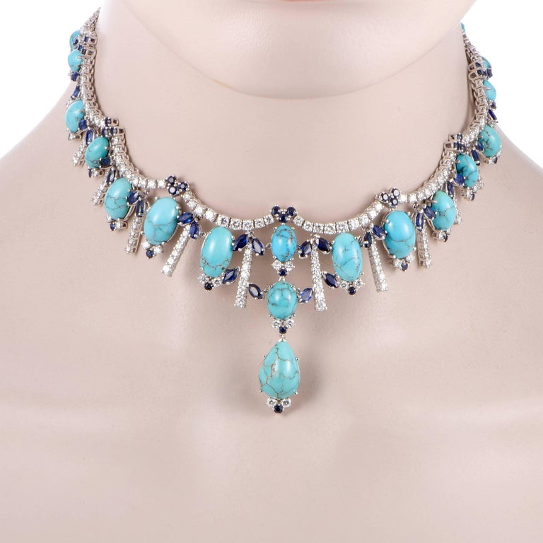 A true representative of what a statement piece looks like, this ravishing necklace is beautifully made of luxurious 18K white gold and extravagantly decorated with a plethora of sapphire, turquoise, and diamond stones. The diamonds amount to 9.86